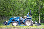 male student on a tractor in a field